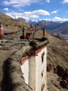 After providing a tour, a lone monk returns to preparing the packed earth roof of Dhnakar monastery ahead of the coming winter in the Spiti Valley.
