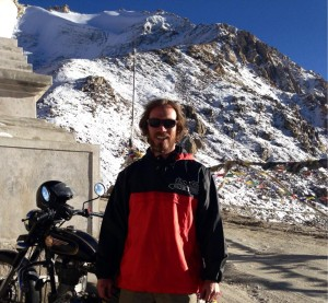 "India's Chang la (5289 m), wearing a second hand jacket from Canada, vacuum sealed and sent to India via a port in Gujarat in perfect, compressed cubes. It is a baseball/softball pullover that reads ""too black"", an apparent pun that would have otherwise outlived its useful life but for an American on the other end."
