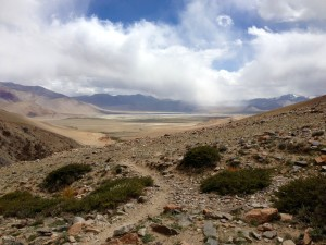 Tso Kar coming into view, descending Shinbuk La (5300) on narrow loose trail.