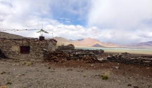Nomads seasonal home at Tso Kar with dry yak dung staked along its stone walls.
