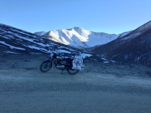 Loaded down and my first pass outside of Rumste, I stop at the top of Taglang on the Leh Manali highway for only a few minutes before I realize how cold it is high, and in the shade. My fingers in gloves are freezing, and it takes some work to restart the bike in the higher altitude. I learn a quick lesson; don't lolly gag or quit your motor in these conditions.
