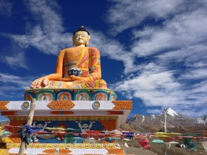 The modern, big bright Budda at Kibber sits on a hill overlooking the valley and Spiti far beyond and even below, likely facing west.