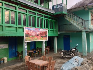 "Modern concrete construction in Chitkula, here my guesthouse. The owner was a nice gentleman, and together we cooked eggs on his kerosene stove in the downstairs kitchen. I stayed in the lower room, and being outside of tourist season, had a military man knock on my door very early in the moringin expecting someone else. I shouted ""he's not hear, go away!"" before at last answering the door and finding the man in fatigues. The solders appear to stop through to use the houses running water."