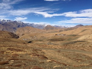 The village of Komic, to the right, and Hikkim to the left. Further left, a gorge that takes the breath away begins to open up to the Spiti and Kaza nearly directly below; the road continues along the high sides with the occasional turret of mountain mixed in with the occasional absence (and thus stacked stones) of mountain.